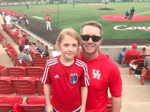 Anslee and me watching Cougar baseball